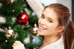 Woman decorating christmas tree Royalty Free Stock Photos
