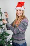 Woman Decorating Christmas Tree With Fairy Lights Stock Photography