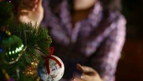 Woman decorating christmas tree stock video