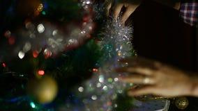 Woman decorating christmas tree stock video footage