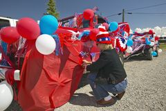 Woman decorating her car in red, white & blue in Lima Montana Stock Photography