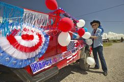 Woman decorating her car in red, white & blue in Lima Montana Stock Photos