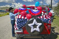 Woman decorating her car in red, white & blue in Lima Montana Royalty Free Stock Image