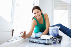 Woman decorating house stock images
