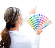 Woman choosing a color for the wall Stock Images