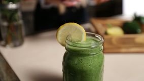 Woman decorating jar of healthy green smoothie stock video footage