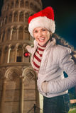Woman decorating Leaning Tower of Pisa with Christmas ball Royalty Free Stock Images