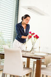 Woman decorating red roses dining room wife royalty free stock photos