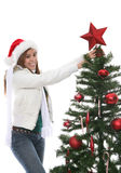 Woman decorating Xmas tree Royalty Free Stock Photography
