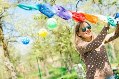 Woman decoration garden party with paper colorful decor stock photography