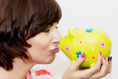 Woman with decorative ceramic piggy bank Royalty Free Stock Photos