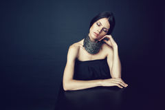Woman in decorative silver necklace Stock Images