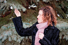 Woman about a decorative tree Stock Image