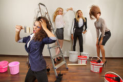 Woman decorators posing with their equipment Royalty Free Stock Photography
