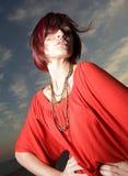 Woman on a deep blue sky Stock Photo