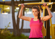 Woman in deep concentration while exercising. Royalty Free Stock Photo