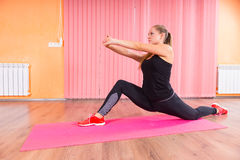 Woman in Deep Lunge Stretch with Arms Forward Stock Images