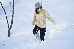 Woman in the deep snow Royalty Free Stock Image