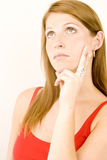 Woman deep in thought Royalty Free Stock Photography