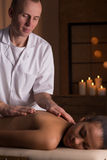 Woman and deep tissue massage. Young relaxed beautiful women having deep tissue massage at beauty resort Royalty Free Stock Photography