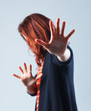 Woman defending. A woman is defending herself royalty free stock photography
