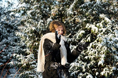 Woman is defending herself playing snowball fight Stock Photos