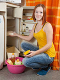Woman  defrosting the refrigerator Stock Image