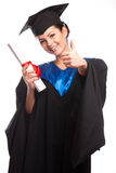 A woman with a degree in her hand as she looks at the camera Stock Photography