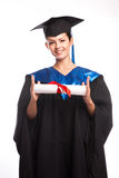 A woman with a degree in her hand as she looks at the camera Stock Images