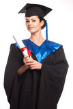 A woman with a degree in her hand as she looks at the camera Stock Photos