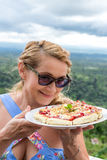 Woman with delicious strawberry pizza on a balinese tropical nature background. Bali island, Indonesia. Stock Images