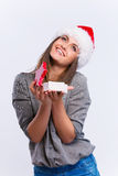 Woman is delight. Beautiful happy girl in christmas red hat is delight, isolated on a white background Stock Image