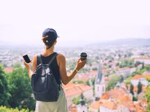 Woman delights panoramic view of Ljubljana City, Slovenia, Europ Royalty Free Stock Images