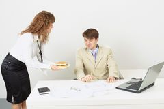 Woman delivered to businessman a hamburger Royalty Free Stock Photo