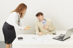 Woman delivered to chief a sandwich to dinner Stock Photos
