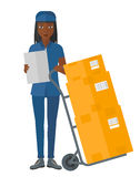 Woman delivering boxes. An african-american delivery woman standing near cart with boxes and holding a file in a hand vector flat design illustration isolated Stock Images