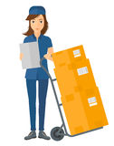 Woman delivering boxes Stock Photos