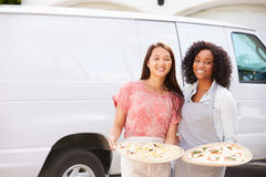 Woman Delivering Pizza Standing In Front Of Van Stock Photos