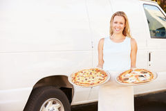 Woman Delivering Pizza Standing In Front Of Van Stock Images