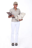 Woman delivering a teddy Royalty Free Stock Photos