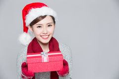A woman delivers christmas gift Royalty Free Stock Photos