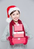 A woman delivers christmas gift Royalty Free Stock Image