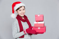 A woman delivers christmas gift Stock Images