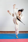 Woman demonstrate martial arts working together. Fighting position, active lifestyle, practicing fighting techniques royalty free stock photos