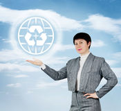 Woman Demonstrates Recycle Sign Stock Image