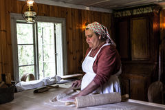 Woman demonstrating bread cooking Stock Photo