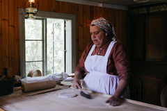 Woman demonstrating bread cooking Stock Image