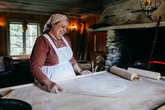Woman demonstrating bread cooking Royalty Free Stock Photography