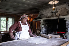Woman demonstrating bread cooking Royalty Free Stock Images