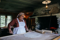 Woman demonstrating bread cooking Stock Photos